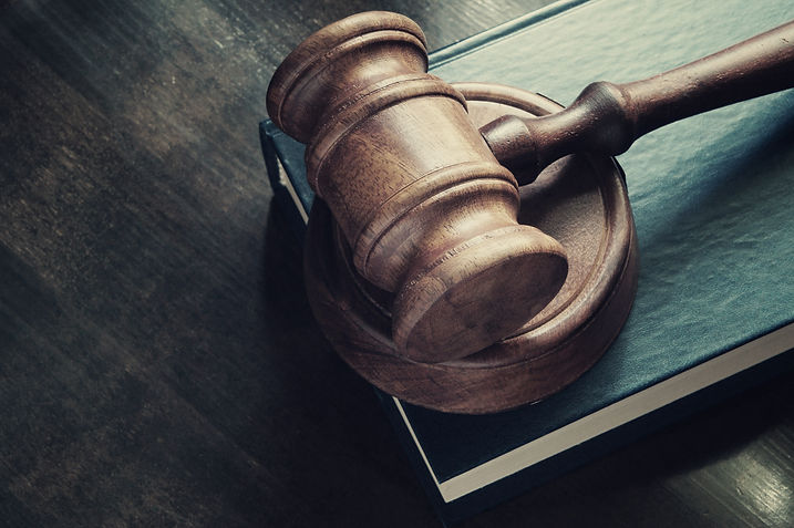Courtroom gavel and legal book