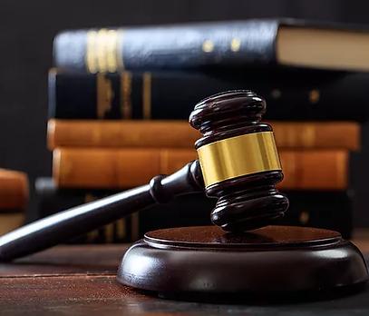 judge-gavel-on-a-wooden-desk-law-books-b.webp