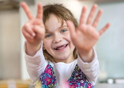 Girl holding seven fingers up.jpg