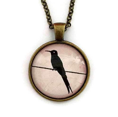 bird on a wire on pink necklace