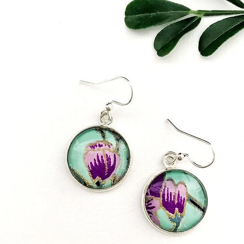 purple flowers on green earrings