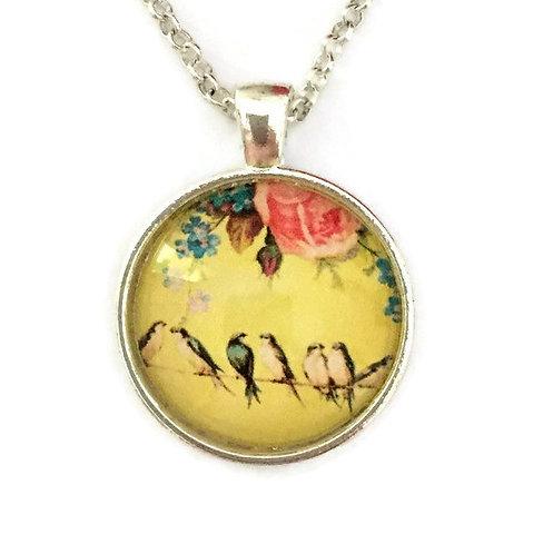 yellow pendant with birds