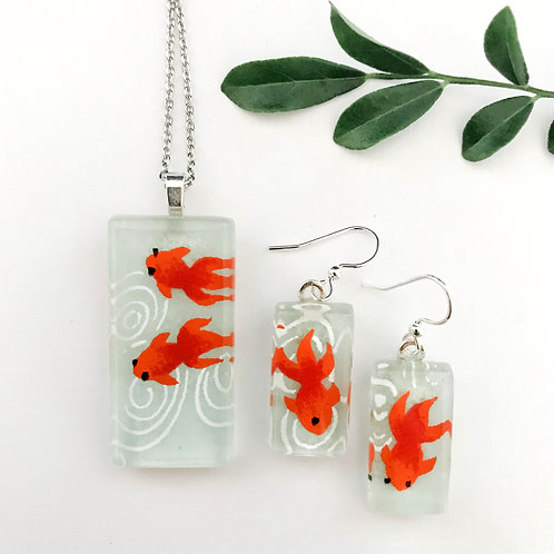 pendant and earring set ~ orange fish on green background