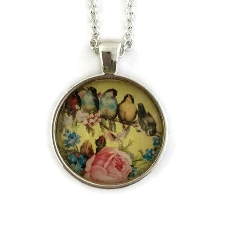 lots of birds on yellow pendant