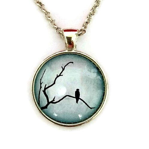 black bird on blue necklace