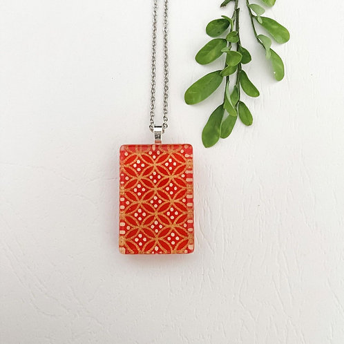 orange gold and white patterned glass necklace