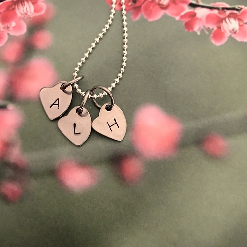 """capital letters on 3 hearts"" necklace"
