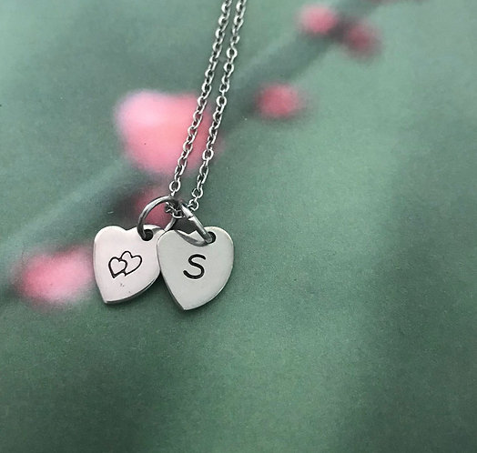 double heart and letter on hearts with chain
