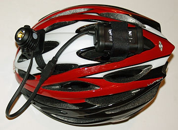 Bike helmet with auxilliary light
