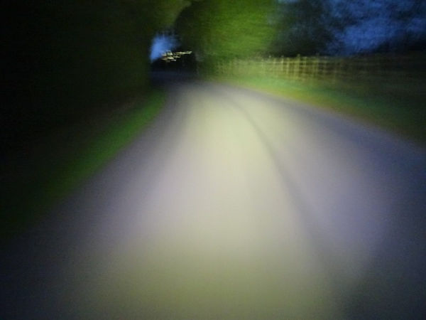 bicycle bike cycle light beam road countryside hedges night