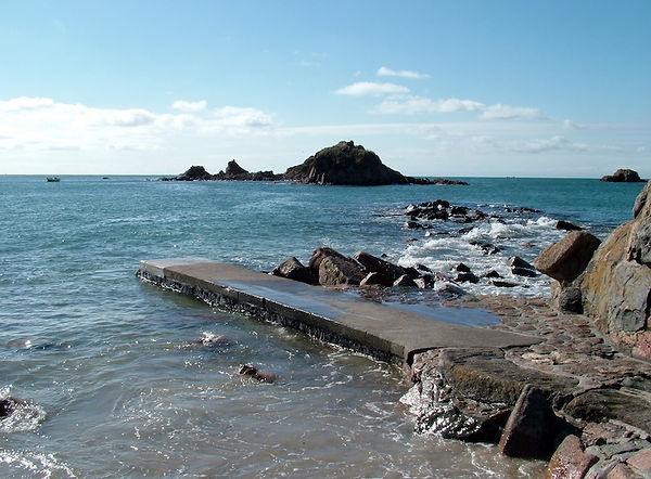 sea rocks crag jetty jersey