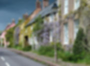 sun dark cloud wisteria cottages village somerset devon