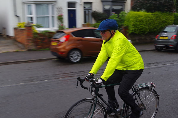 cyclist riding bike water proof wet gear