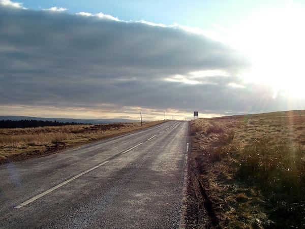Road sunset moor