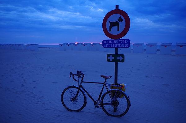 Bike sea side sand light evening summer sign