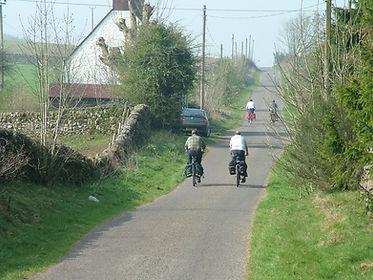 Cyclists Dunscore, Dumfries empty roads