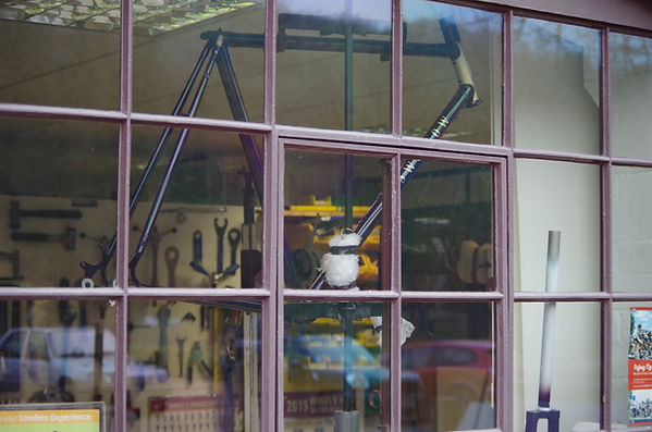Swallow bespoke bicycle frame in window of bicycles by design