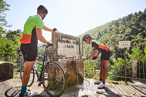 cyclists water fountain drinking trees madonna della grazie