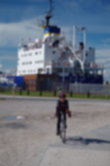 Ships near Barrow in Furness, with cyclist