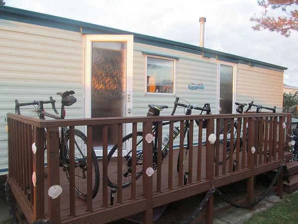 Bicycles, static caravan, sunset