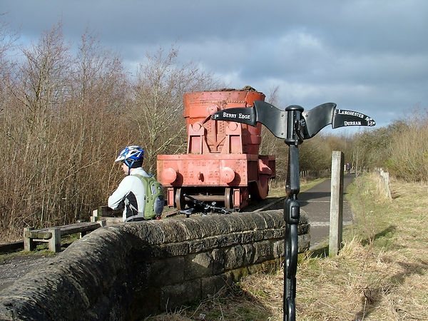 MTBer and a sign of Consett's past, on the C2C route.