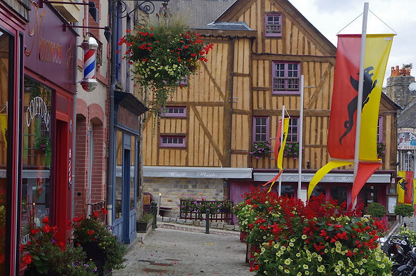 Domfront Normandy normandie France flags shops colourful