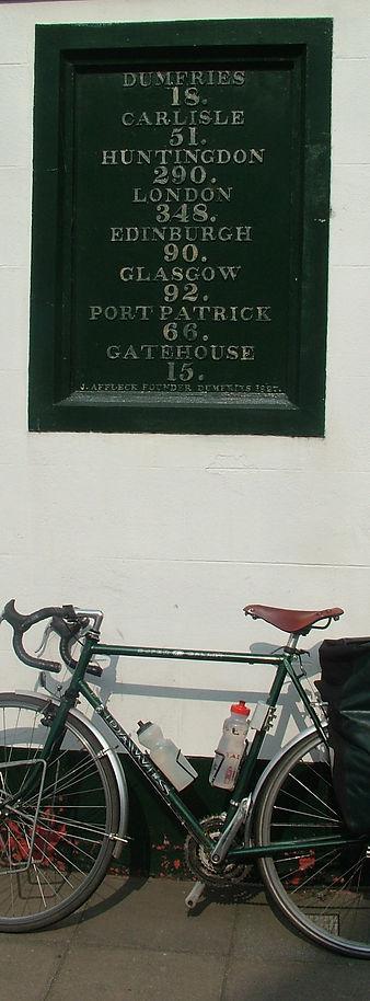 Bike and milepost mile board Castle Douglas