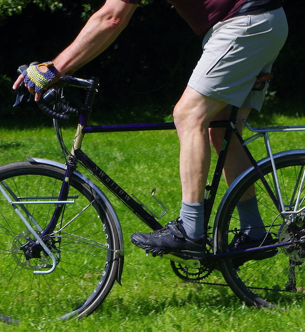 shorts cyclist standing riding bicycle