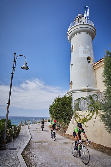 lighthouse cyclists sea coast cycling bicycle italy