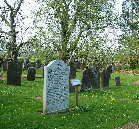 The Macmillan headstone in the old graveyard, Keir Mill, marking the burial place of Kirkpatrick Macmillan