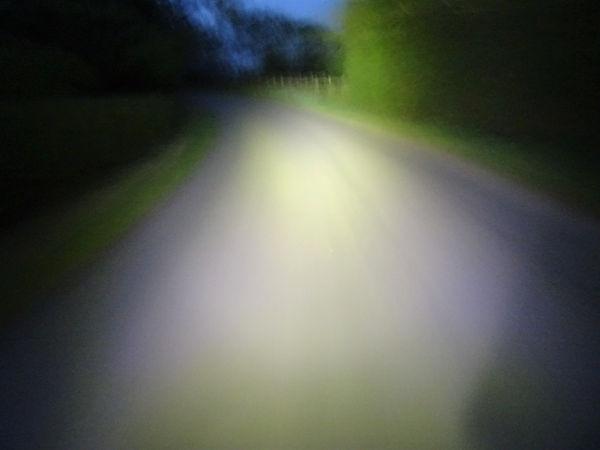 bike light beam cycle country lane back road