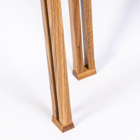 Legs: Showing the tapered twin-pillars a