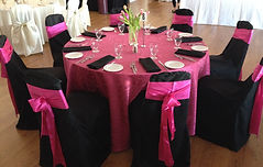 Wedding guest table chair covers, sashes, linens, place settings, napkins in black and pink