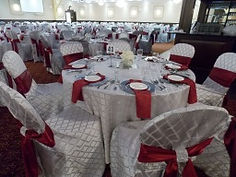 Wedding guest table chair covers, sashes, linens, place settings, napkins in white and burgandy