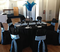 Wedding guest table chair covers, sashes, linens, place settings, napkins in blue and black