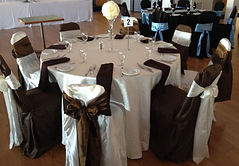 Wedding guest table chair covers, sashes, linens, place settings, napkins in brown and cream