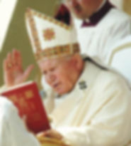 Pope John Paul II reads the word of canonization declaring Sr. Faustina Kowalska a saint