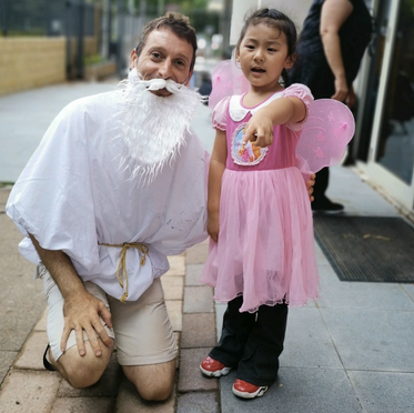 Teachers and kids in fancy dress costumes at our Purim event.