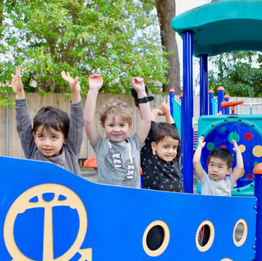 Kids having fun on the ship in the playground at Apples & Honey Preschool.