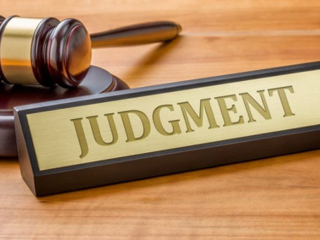 When is a Default Judgment listed against a debtor?