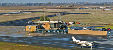Merced Airport with plane landing in the foreground