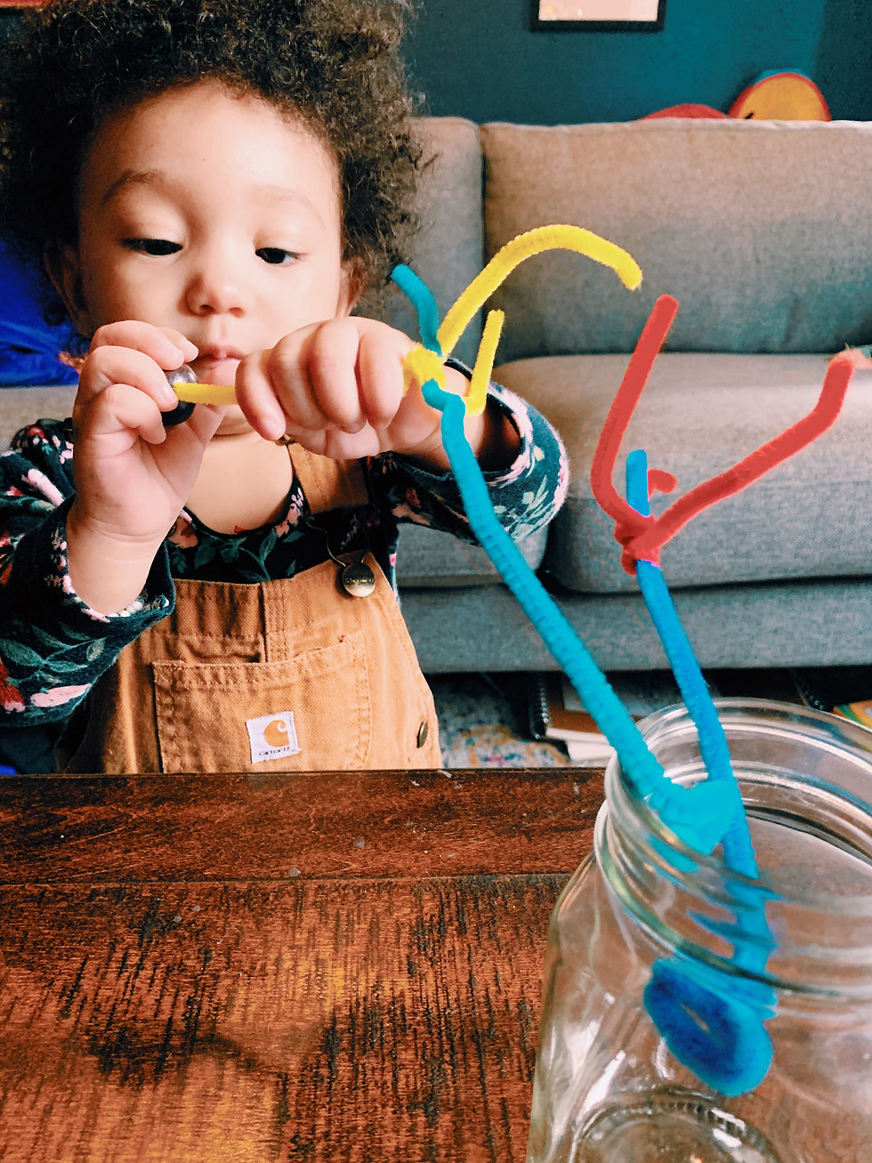 child playing a fine motor activity