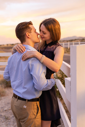 Man and woman about to kiss during sunset by Las Vegas Engagement photographer Jennifer Hyman