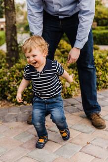 Cute running toddler boy