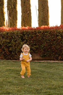 Little toddler girl dressed in yellow jumper