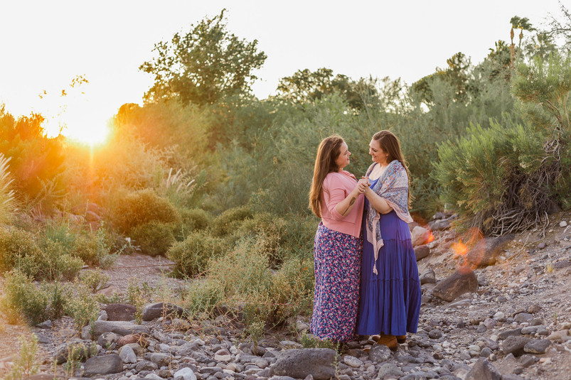 Two women dancing in the sunset