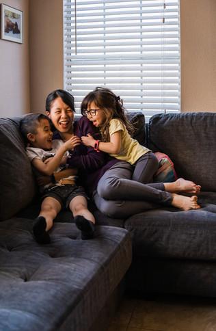 Kids tickling mom