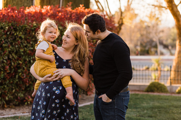 Family maternity session with greenery