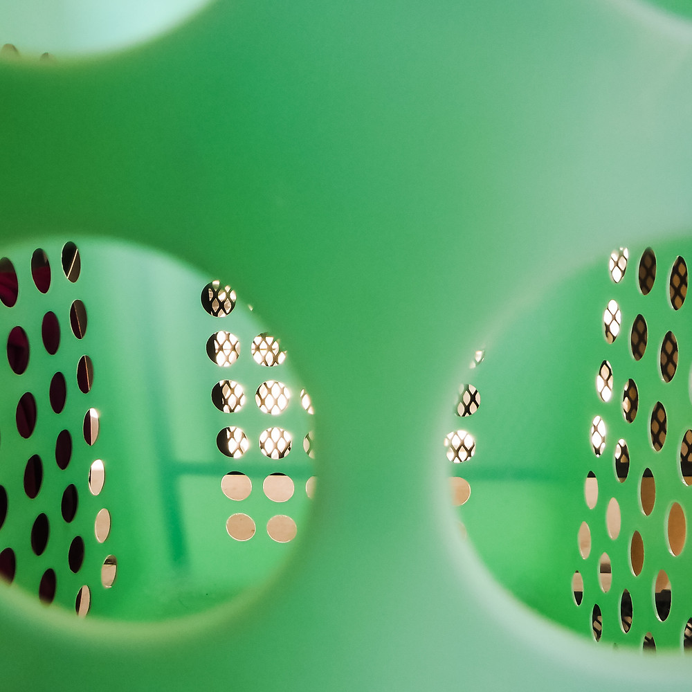 Closeup view through holes in a laundry basket