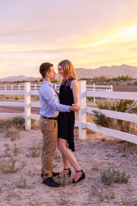 Couple dancing in the desert during sunset